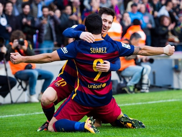 Luis Suarez celebrates with Lionel Messi after scoring his team's second goal during the La Liga match between FC Barcelona and Club Atletico de Madrid at Camp Nou on January 30