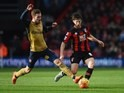 Harry Arter and Aaron Ramsey in action during the Premier League game between Bournemouth and Arsenal on February 7, 2016