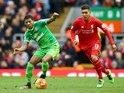 Patrick van Aanholt and Roberto Firmino in action during the Premier League game between Liverpool and Sunderland on February 6, 2016