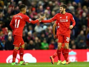 Adam Lallana celebrates scoring with Roberto Firmino during the Premier League game between Liverpool and Sunderland on February 6, 2016