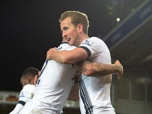 Harry Kane celebrates with Kyle Walker during the Premier League game between Norwich and Spurs on February 2, 2016