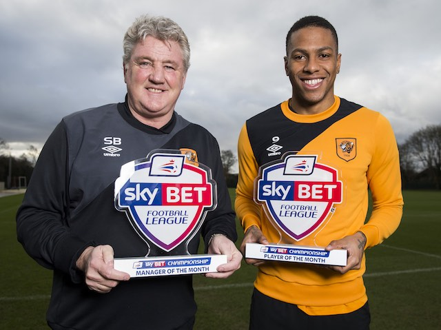 Hull City's Abel Hernandez and big bloody Steve Bruce pose with their player and manager of the month awards for January 2016