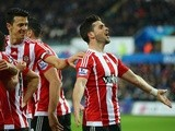 Shane Long of Southampton celebrates scoring his team's first goal against Swansea City on February 13, 2016
