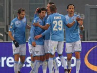 Alessandro Matri of Lazio celebrates with teammates after scoring in his side's 5-2 victory over Hellas Verona on February 11, 2016