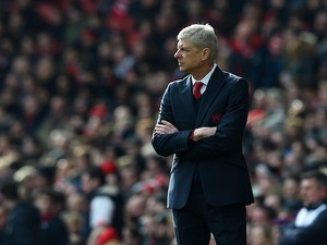 Arsene Wenger watches on during the Premier League game between Arsenal and Leicester City on February 14, 2016