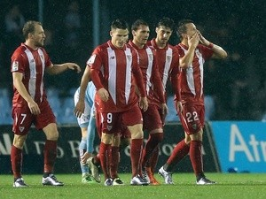 Sevilla's Yevhen Konoplyanka celebrates a goal with teammates during the  Copa del Rey semi-final second leg against Celta Vigo on February 11, 2016