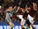 Miralem Pjanic and Konstas Manolas gang up on Karim Benzema during the Champions League match between AS Roma and Real Madrid on February 17, 2016