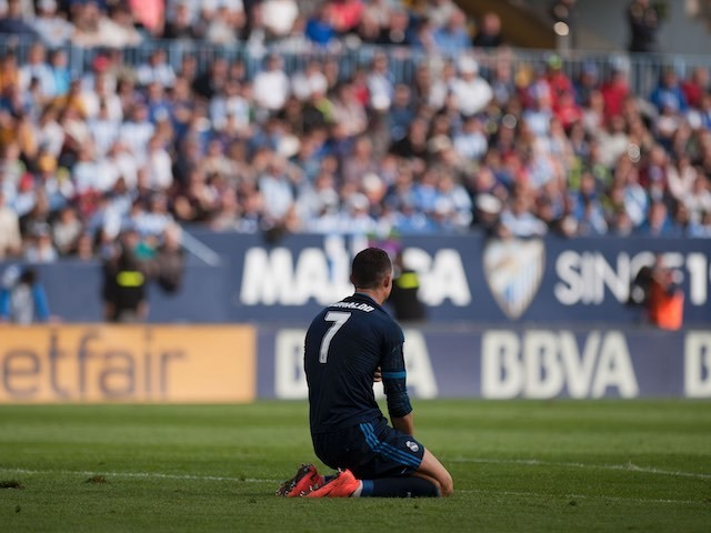 Cristiano Ronaldo goes down on his knees after missing a penalty during the La Liga game between Malaga and Real Madrid on February 20, 2016