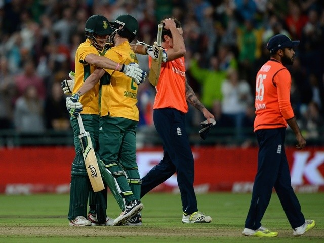 Kyle Abbott and Chris Morris of South Africa celebrate as Reece Topley of England reacts after winning the first T20 international match on February 19, 2016