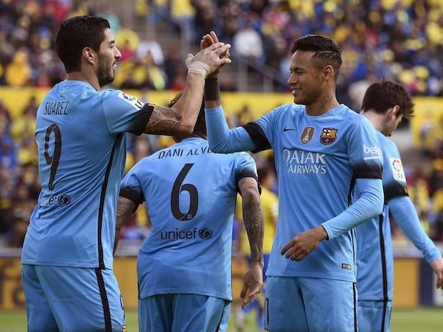 Luis Suarez celebrates with Neymar during the La Liga game between Las Palmas and Barcelona on February 20, 2016