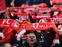 A crowd of Barney Corkhills wave their scarves during the League Cup final between Liverpool and Manchester City on February 28, 2016