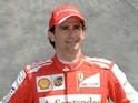 Ferrari test driver Pedro de la Rosa of Spain poses on March 14, 2013