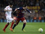 Benoit Tremoulinas and Lionel Messi in action during the La Liga game between Barcelona and Sevilla on February 28, 2016