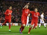 James Milner celebrates with Philippe Coutinho and Roberto Firmino during the Europa League game between Liverpool and Augsburg on February 25, 2016