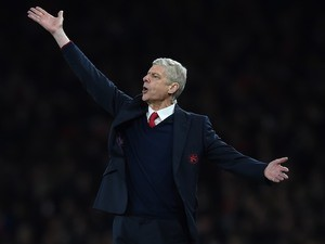 Arsene Wenger practises semaphore during the Champions League game between Arsenal and Barcelona on February 22, 2016