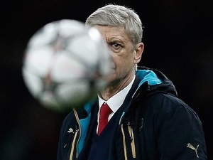 Arsene Wenger plays hard to get during the Champions League game between Arsenal and Barcelona on February 22, 2016