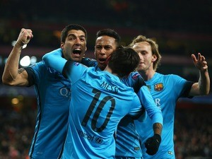 Lionel Messi, Neymar and Luis Suarez celebrate a rare goal during the Champions League game between Arsenal and Barcelona on February 22, 2016