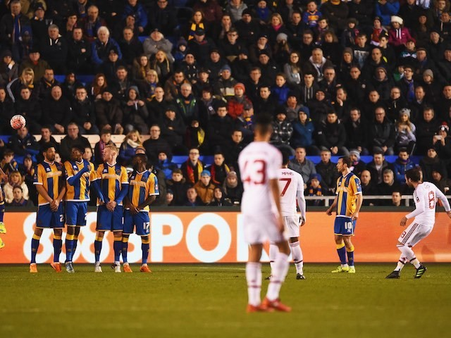 Juan Mata scores from a free kick during the FA Cup game between Shrewsbury Town and Manchester United on February 22, 2016