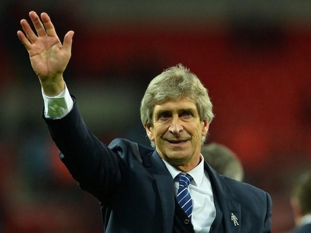 Manchester City boss Manuel Pellegrini celebrates winning the League Cup on February 28, 2016