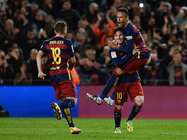 Lionel Messi celebrates scoring with Neymar as Jordi Alba approaches during the La Liga game between Barcelona and Sevilla on February 28, 2016