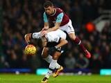Aaron Cresswell of West Ham United mounts Erik Lamela of Tottenham Hotspur on March 2, 2016