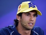 Sauber's Felipe Nasr takes part in a press conference at the Interlagos pits on November 12, 2015