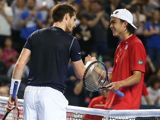 Great Britain's Andy Murray shakes hands with Japan's Taro Daniel after winning their Davis Cup world group first-round men's singles match on March 4, 2016