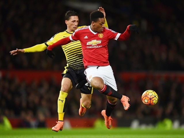 Anthony Martial of Manchester United battles for the ball with Jose Holebas of Watford on March 2, 2016