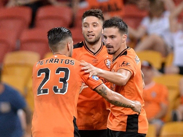 Jamie Maclaren celebrates scoring a goal during the A-League match between the Brisbane Roar and the Western Sydney Wanderers at Suncorp Stadium on March 4, 2016