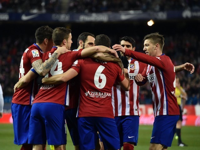 Luciano Vietto celebrates with teammates during the La Liga game between Atletico Madrid and Real Sociedad on March 1, 2016