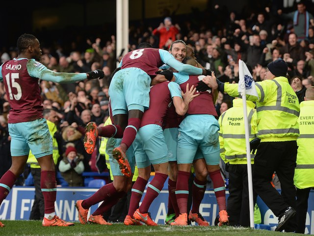 Dimitri Payet celebrates scoring the winner during the Premier League game between Everton and West Ham United on March 5, 2016