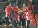 Athletic players celebrate after scoring during the Europa League game between Athletic Bilbao and Valencia on March 10, 2016