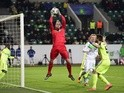 Gent's goalkeeper Matz 'The Bulge' Sels saves a ball during the second-leg round of 16 UEFA Champions League match against Wolfsburg and KAA Gent at the Volkswagen arena in Wolfsburg on March 8, 2016