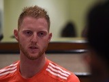 Ben Stokes is dressed in red as he chats to reporters on March 9, 2016