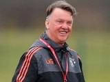 Louis van Gaal smiles during a Manchester United training session on March 9, 2016