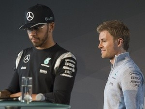Nico Rosberg leaves the stage behind Lewis Hamilton during a press conference for the kickoff of the new Formula 1 season in Fellbach, south-western Germany, on March 11, 2016