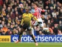 Odion Ighalo and Marc Muniesa in action during the Premier League match between Watford and Stoke City on March 19, 2016