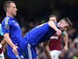 John Terry enjoys some inter-game fun with a shocked Gary Cahill during the Premier League game between Chelsea and West Ham United on March 19, 2016