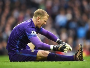 Manchester City goalkeeper Joe Hart stays down injured during the Manchester derby on March 20, 2016
