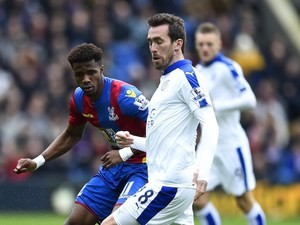 Wilfried Zaha and Christian Fuchs in action during the Premier League game between Crystal Palace and Leicester City on March 19, 2016