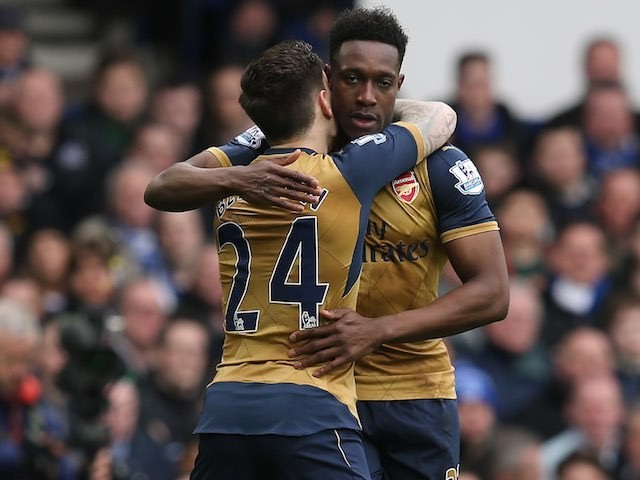 Danny Welbeck celebrates scoring the opener with Hector Bellerin during the Premier League game between Everton and Arsenal on March 19, 2016
