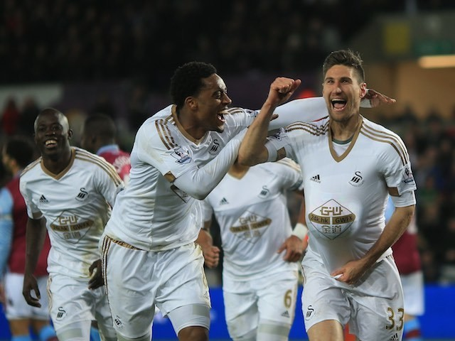 Federico Fernandez celebrates scoring with Leroy Fer during the Premier League game between Swansea City and Aston Villa on March 19, 2016