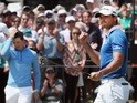Jason Day celebrates after defeating Rory McIlroy in the semi-finals of the World Golf Championship-Dell Match Play on March 27, 2016