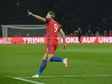 Harry Kane celebrates pulling one back during the international friendly between Germany and England on March 26, 2016