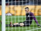 Jack Butland sits injured during the international friendly between Germany and England on March 26, 2016
