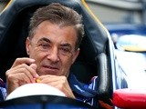 Jean Alesi sits in a car after qualifying for the Formula 1 Grand Prix of Austria at Red Bull Ring on June 20, 2015