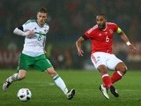 Steven Davis of Northern Ireland and Ashley Williams of Wales in action on March 24, 2016