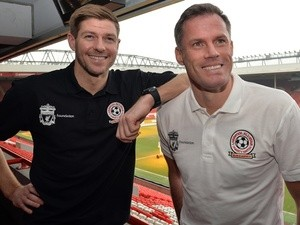 Steven Gerrard and former Liverpool teammate Jamie Carragher ahead of an All-Star charity match on March 12, 2015