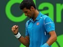 Novak Djokovic celebrates a point during the Miami Open final on April 3, 2016