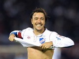 Uruguayan Nacional's player Alvaro Recoba celebrates the third goal against Chilean Iquique during their Copa Sudamericana football match at the Centenario Stadium in Montevideo on August 14, 2012